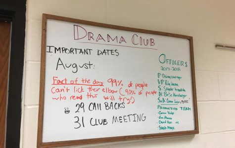 Drama Club President Delaney Echelmeyer, finishes the Drama Club announcement board with new announcements for the day.