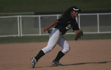 Senior Sahaura Pauley fields a ground ball vs. Troy on 8/28.