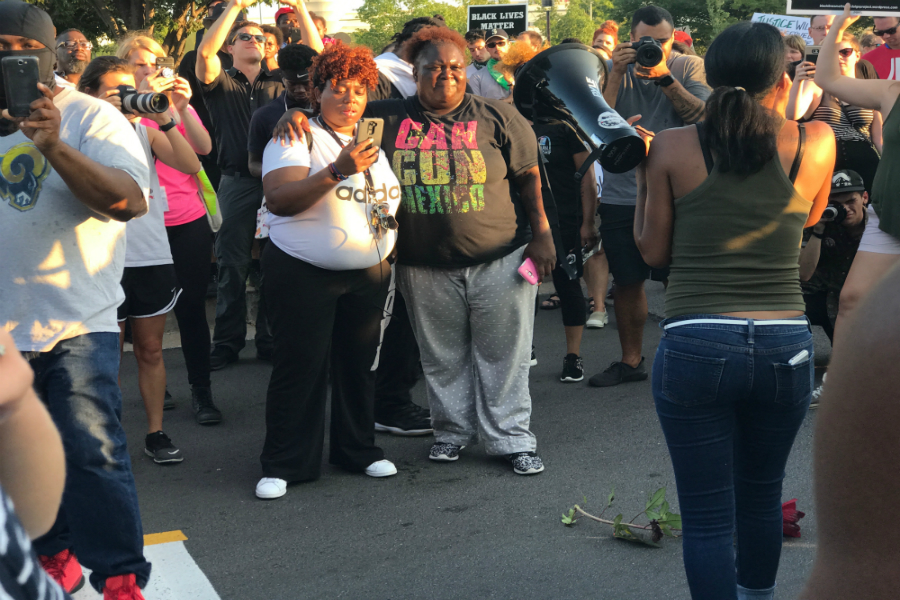 Protesters follow their leaders chants on Sept. 20, at the Galleria Mall.