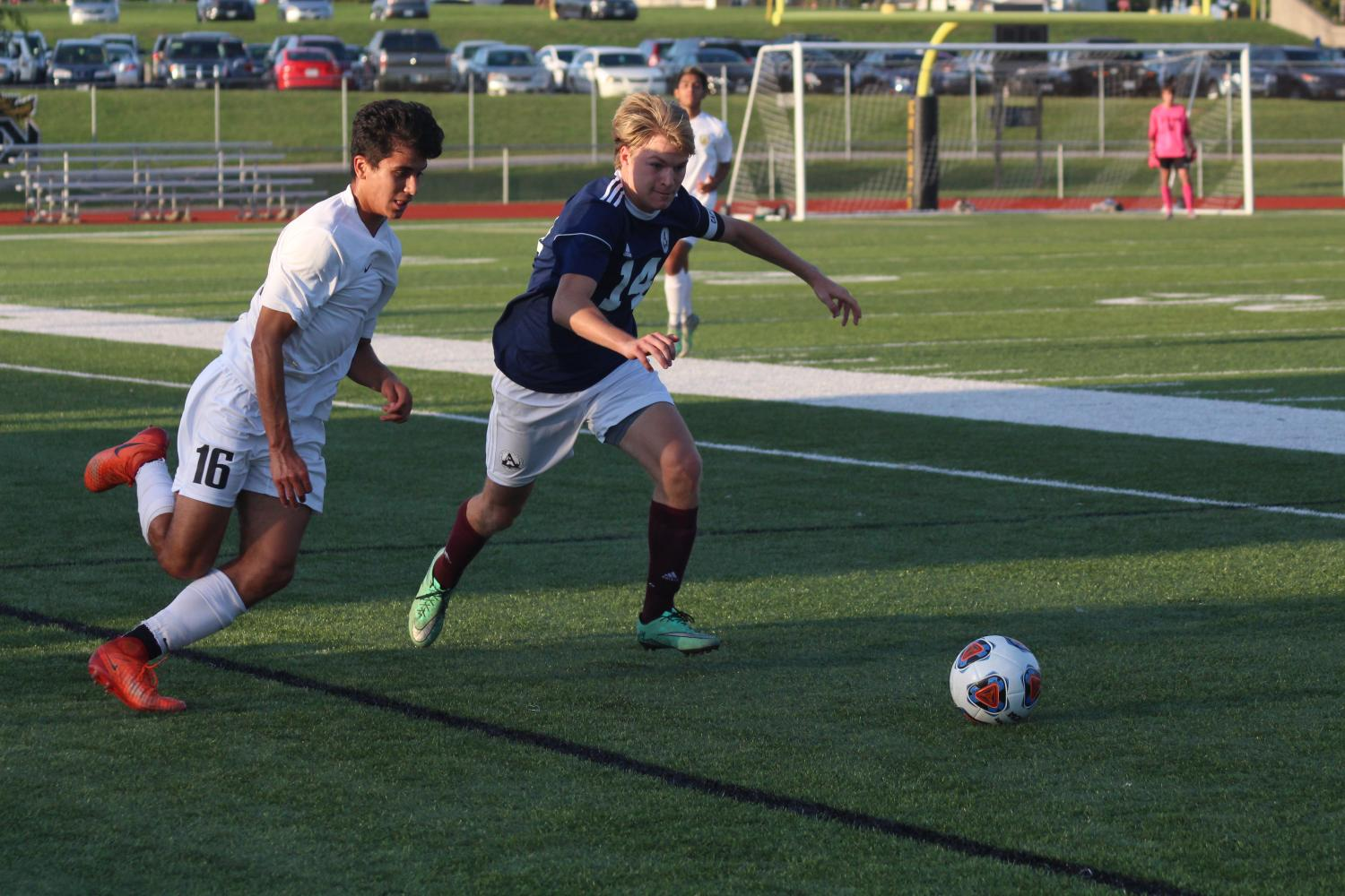 Senior Taylor Elzein runs towards the ball. Boys' varsity soccer played against the FHC Spartans on Sept. 5. The game tied 1-1 which forced the teams to go into overtime. The Knights won 2-1 due to Joel Arena's winning shot in penalty kicks.
