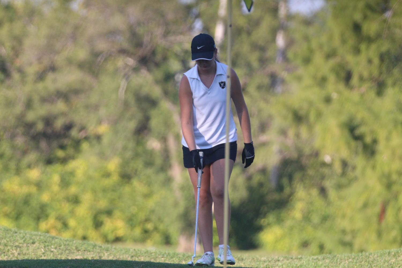 Senior Briana Schmidt prepares for a putt on Sept. 14.