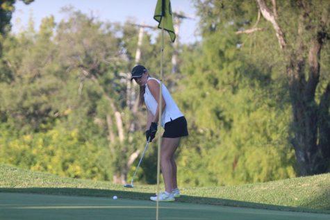 Senior Briana Schmidt prepares for a short putt in a match on 9-14.