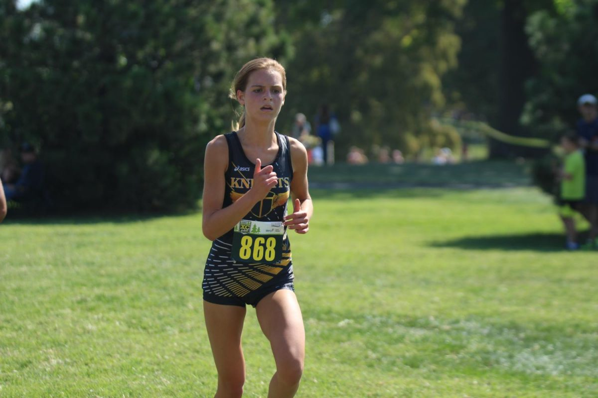 Sophomore+Paige+Hercules+runs+in+a+meet+at+Forest+Park+on+Sept.+9