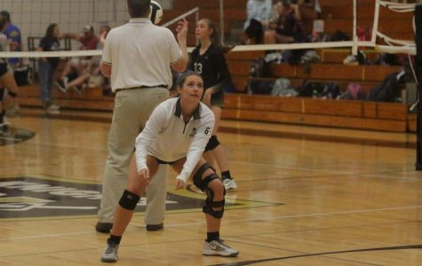 Senior Caty Arnold warms up with the team Thursday, Sept. 7 against Timberland. Due to injury, Arnold has not been able to participate in any games this year. The Knights lost in two sets.