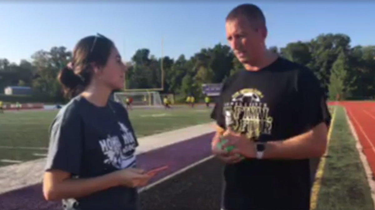 Senior Jamie Sneed talks with Boys Soccer coach Larry Scheller before a game at Fort Zumwalt West.