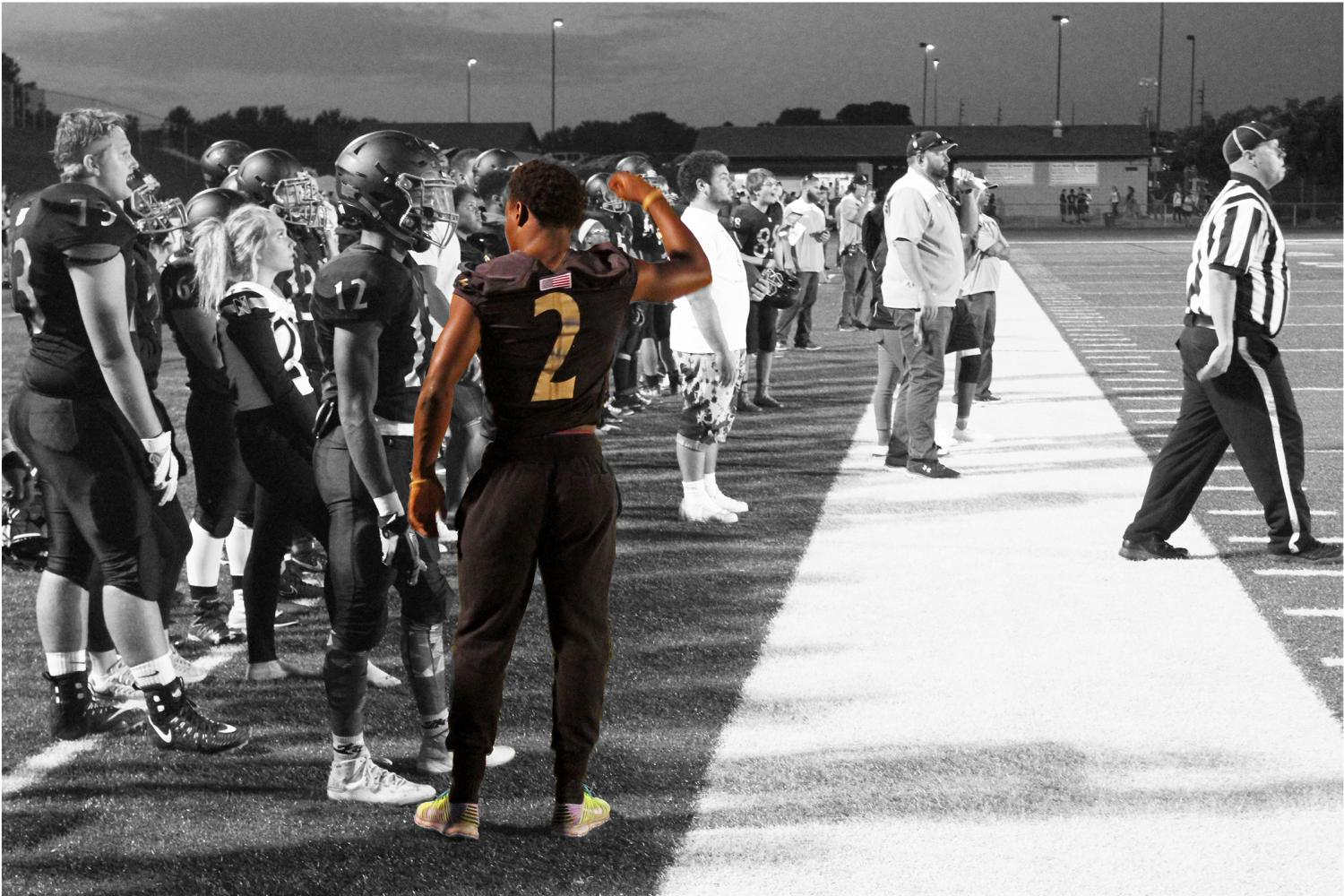 Taron Woods stands on the sideline as he watches the game against Fort Zummwalt West on Sept. 8. The final score was 48-0 FZW (Photo Illustration by Jordan Milewczik and McKayla Bogda)