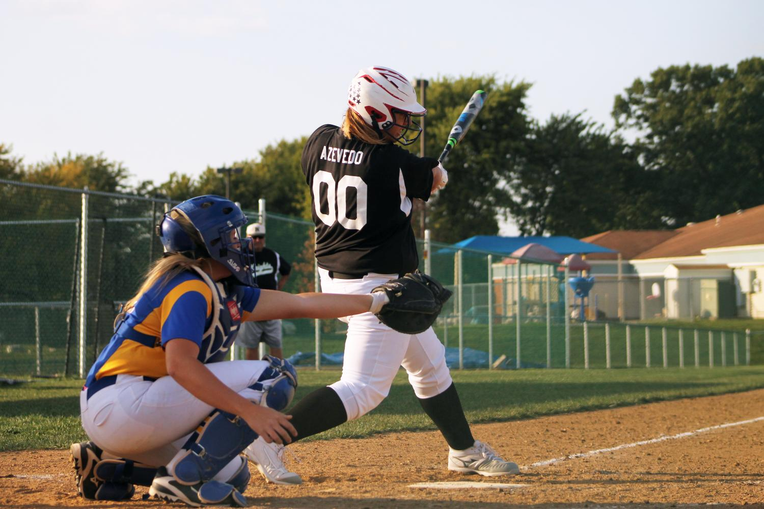 On Sept. 5, senior Brianna Azevedo scores the first run of the varsity softball game against FHHS. At the end of the game, seven more runs were hit by her teammates after her. They lost with a score of 8-13.