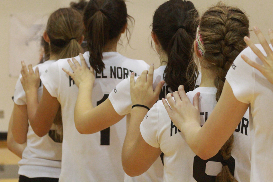Girl Varsity volleyball lines up for National Anthem before match against FZW on 9/19.