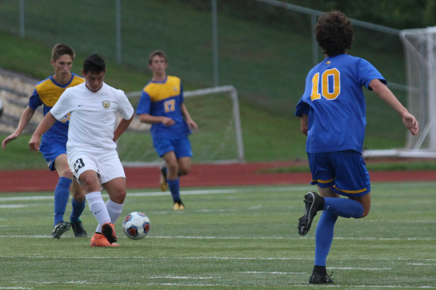 Mateo Morales works to keep the ball away from the Howell defender.