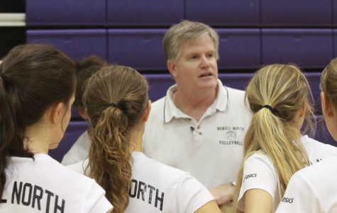 Coach Kent Stover gives a pep talk to his team before the match.