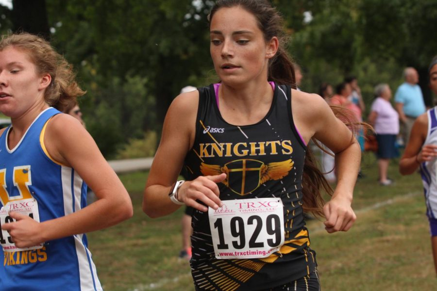 Junior Claire Huss participating in cross country meet