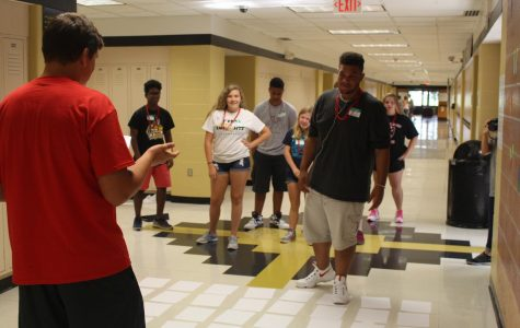 FHN Mentor guides new freshmen through the hallways, giving them a tour of the school.