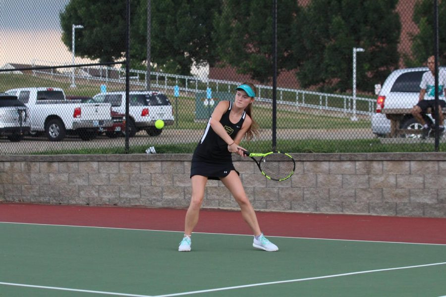 Maddie+Oswald+prepares+to+hit+the+ball+back+over+the+net.