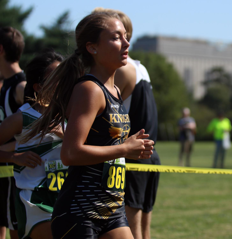Senior Maggie Hillmann runs in a varsity cross country meet for FHN.