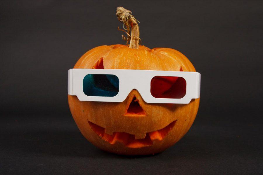 Orange halloween pumpkin in 3d glasses on black background.