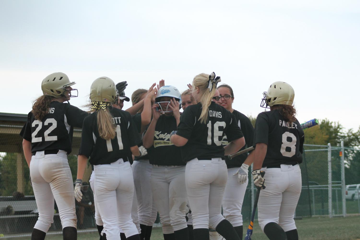 The Knights celebrate a home run vs. Troy on 9/12.