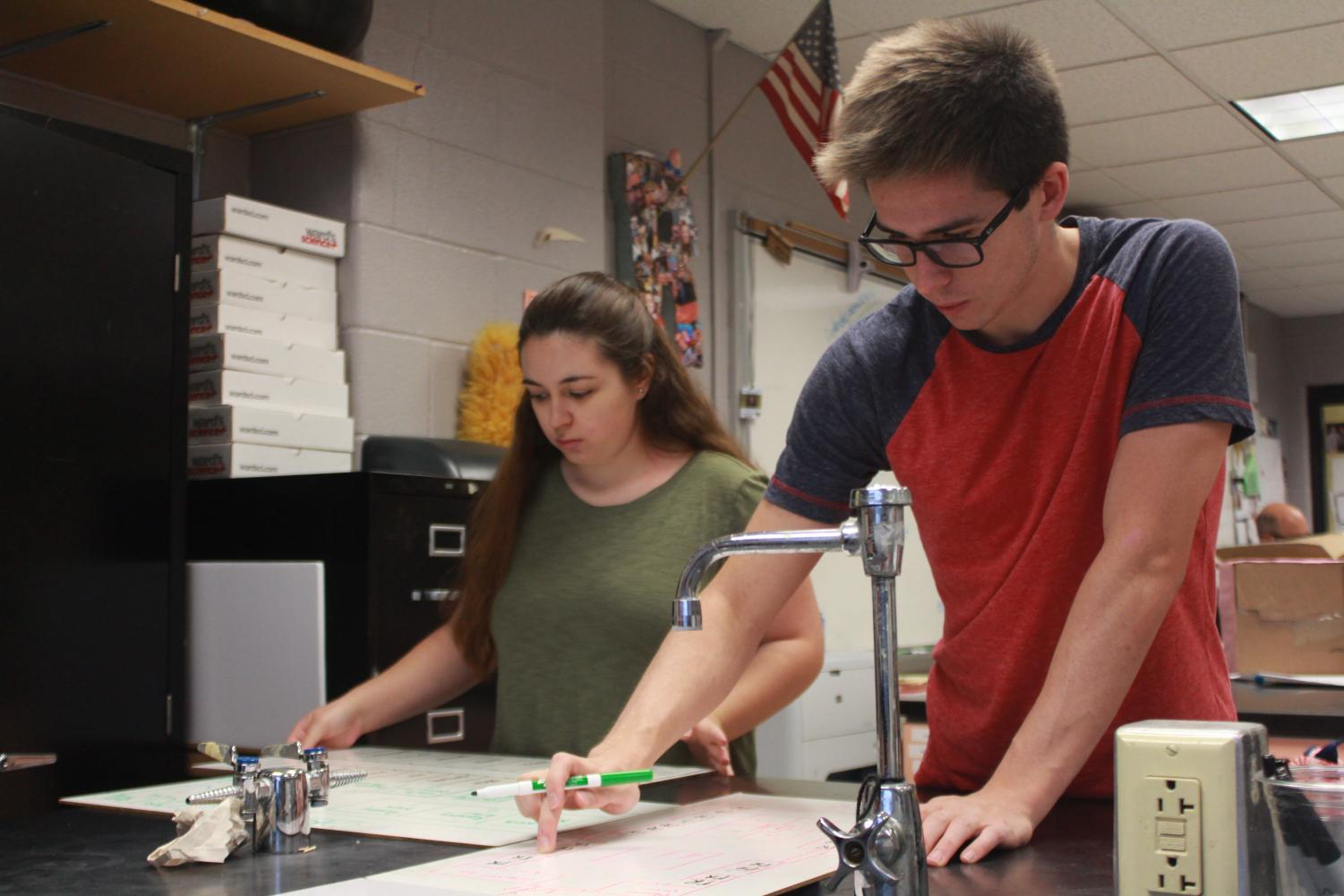 Cooper Redington and Sophia Couteranis work on designing an emergency room floor plan in their Biomedical Innovations class. To take this class they both must travel from their school, FHC, to FHN due to the class not being offered there. This is the first year BI has been offered at FHN.
