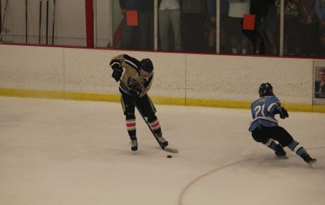 The Knights take possession of the puck vs. Francis Howell in their annual Gold Cup game on 11/4.