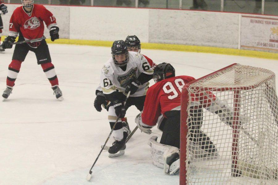 Freshman Kyle Vossmeyer attempts to skate around Fort Zumwalt West's goaltender on 11/10.