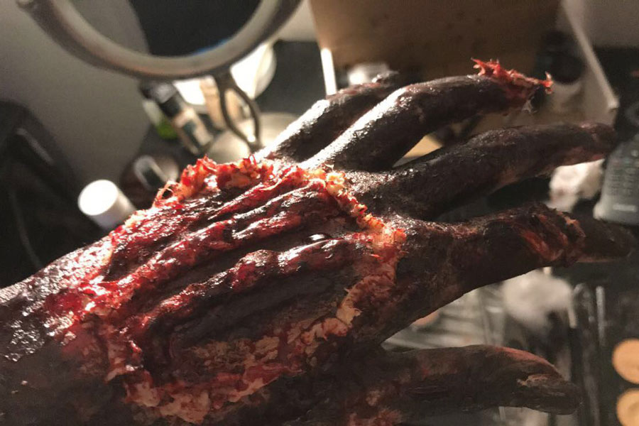 Freshman Olivia Engle portrays her special effects makeup on a hand. Engle has been practicing for a little over two years. Each full look takes about an hour depending on what needs to be done.
