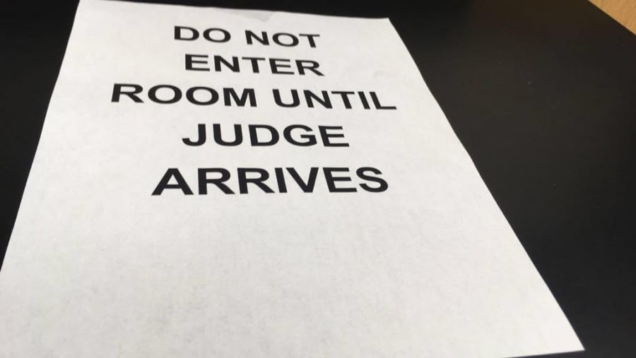 At the Speech and Debate tournament, signs were hung around the school to inform competitors of rules. (file photo)