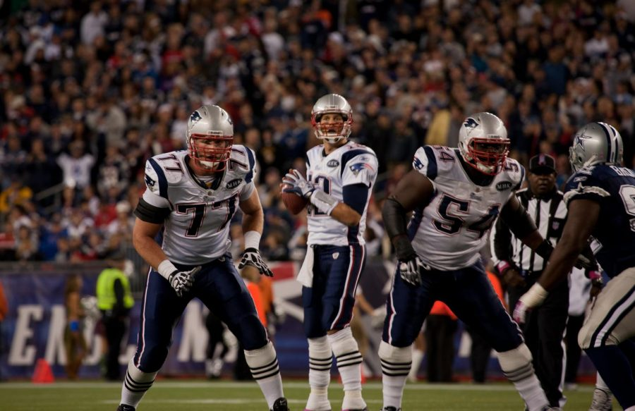 BOSTON - OCTOBER 16: Quarterback Tom Brady, No 12, prepares to throw pass at Gillette Stadium, New England Patriots vs. Dallas Cowboys on October 16, 2011 in Foxborough, Boston, MA