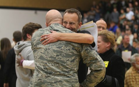 FHN Alumni Kenneth Kaibel embraces former Publications Adviser, Aaron Manfull. Kaibel was the guest speaker at FHN's first annual Veteran's Day assembly on Nov. 10. (pictured in his Military uniform)