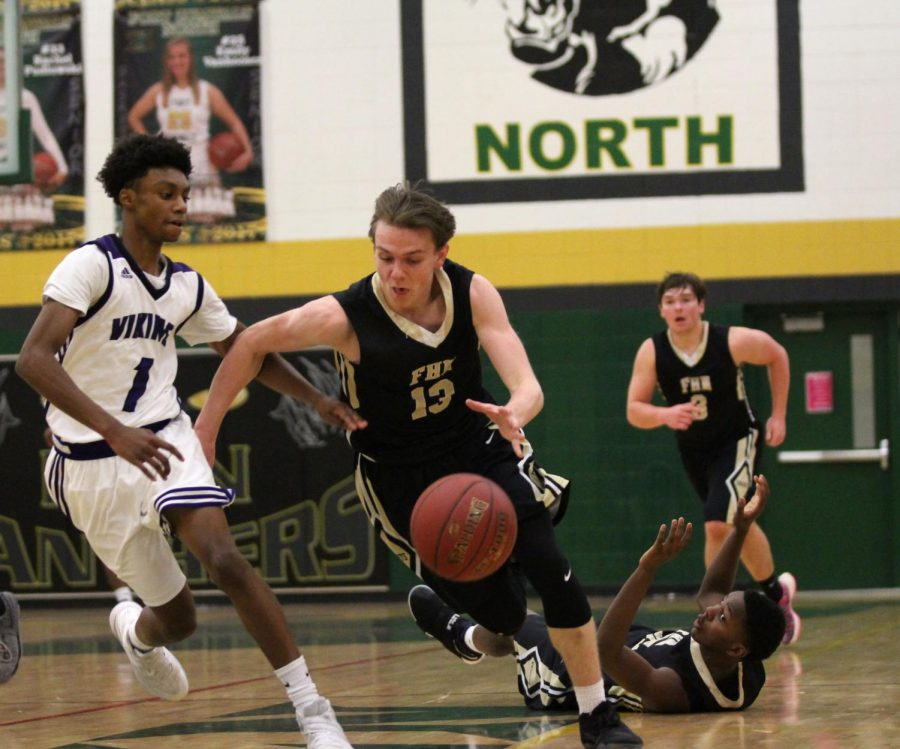 Senior Drew Killmer drives past defender