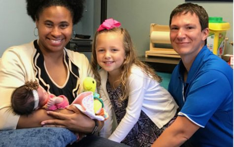 Tim, Tiffany and Evelyn Besse pose for a family photo with their new daughter Stella. (photo submitted)