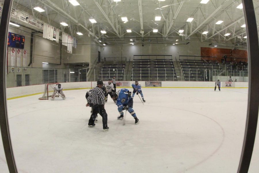 The+Vikings+and+Knights+varsity+hockey+teams+line+up+for+a+face-off+on+Dec.+10+at+the+Rec+Plex.
