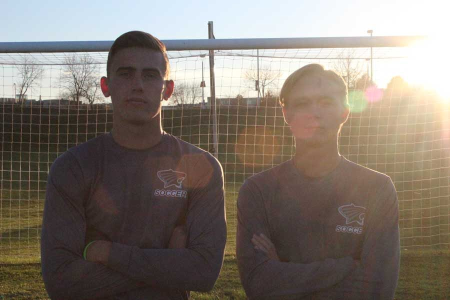 Alumni Michael Scanlon and Anthony Kristensen stand together in front of the net at St. Charles Community College.