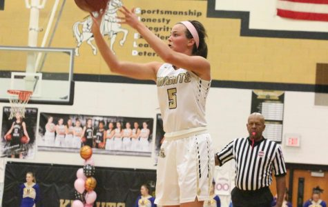 Junior Gabby Delarue attempts a shot in a varsity basketball game in the Howell North gym.