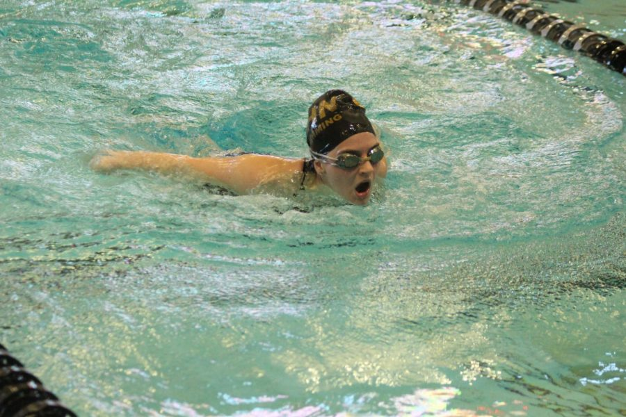 The varsity girls swim team competes in a meet for FHN.