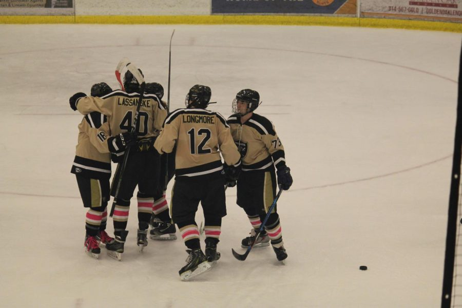 The hockey team, with Blaine Longmore as number 12, huddles together after scoring a goal against the Francis Howell Vikings during the 2017 Gold Cup. The game is an annual event between the two teams taking place early in the season. The Knights would eventually drop the game 8-2. The matchup will happen two more times this regular season on Dec. 9 and Dec. 29.