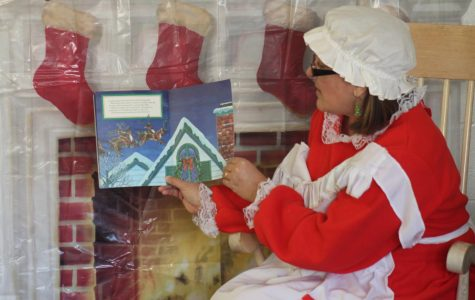 """Mrs. Claus reads a christmas story to the children. On Dec. 2 Becky David Elementary hosted """"Breakfast with santa."""" Families from all over came to enjoy stories with mrs.claus, a picture with santa, breakfast, and fun games and crafts."""