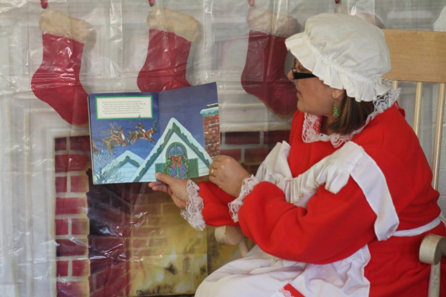 "Mrs. Claus reads a christmas story to the children. On Dec. 2 Becky David Elementary hosted ""Breakfast with santa."" Families from all over came to enjoy stories with mrs.claus, a picture with santa, breakfast, and fun games and crafts."
