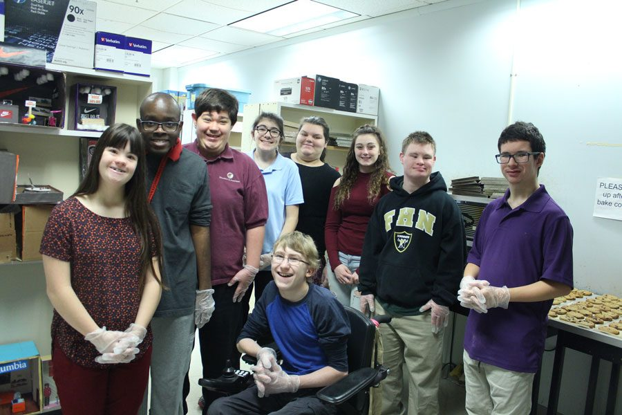 Some of the students involved in baking DECA cookies pose for a group photo.