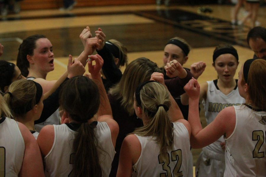 The varsity girls Lady Knights basketball team huddles for a time out in the Howell North gym on 1/16 vs. Timberland.