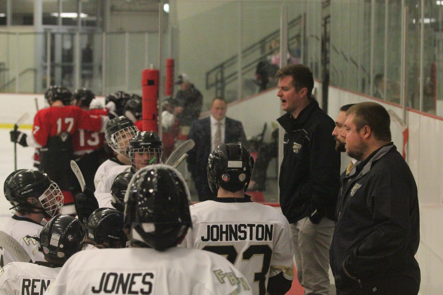 Varsity hockey coach Ryan Gannon talks to his team during a stoppage of play on 11/10 vs. Fort Zumwalt South.