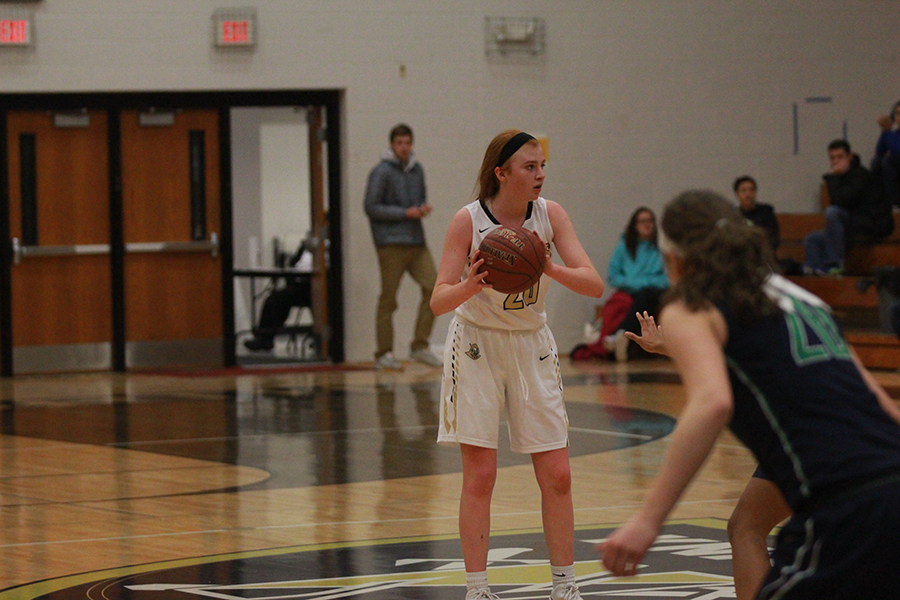 Freshman Isabelle Delarue dribbles up the court during a game against Timberland.