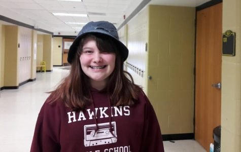 KOE Member Hannah Davis poses in the hat she wore on Feb. 7 for KOE's third hat day. All money from this fundraiser will be donated to FHN's adopt a family.