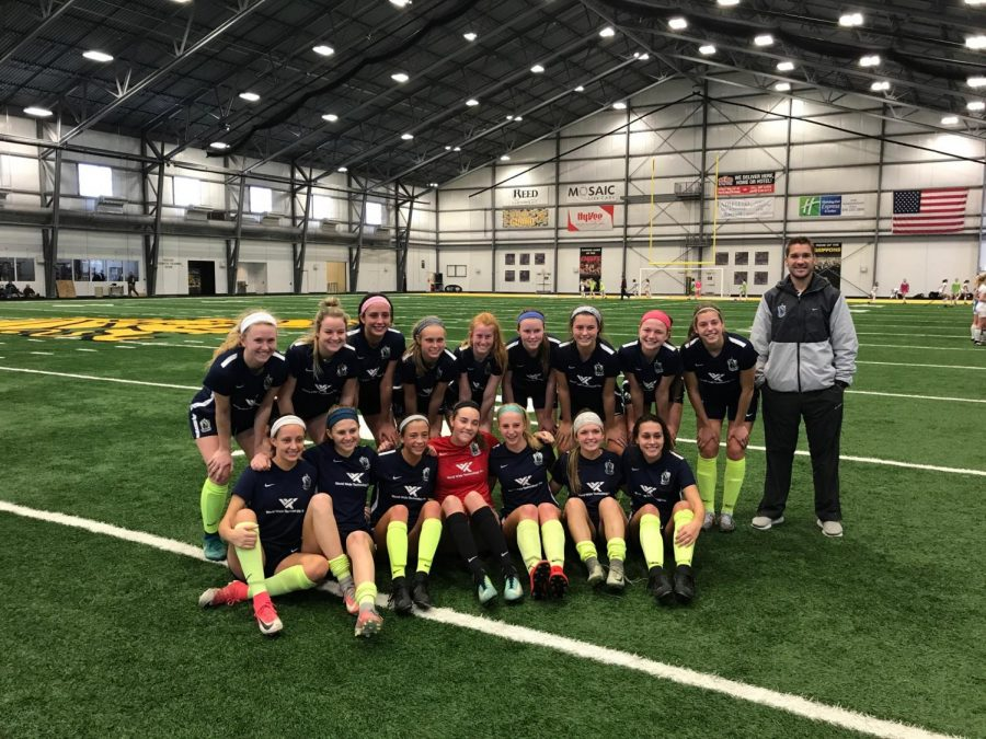 Junior Abbie Miller poses for a picture after a game with her soccer team. Miller has been playing Scott Gallagher Elite for four years. Miller is seated on the bottom row on the far left. (Photo submitted)