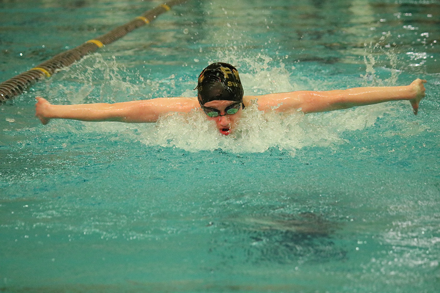 Senior Erin Stock swims in a varsity girls meet vs. Timberland and Francis Howell on 1/9.