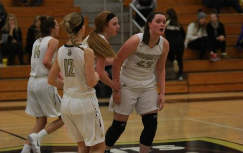 The Lady Knights varsity basketball team huddles up at half court during their home game vs. Timberland on 1/16.