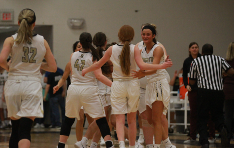 The Lady Knights head over to the bench during a timeout in their game against Timberland on 1/16.