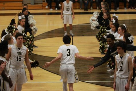 Junior Max Smallwood  heads onto the FHN  court in the large gym in a game against Timberland.