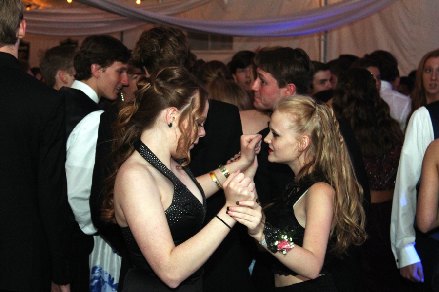 Haley Geer and Autumn Davis dance at last year's Prom on May 6 in New Town. The theme for the dance was a Knight in Hollywood. (file photo)