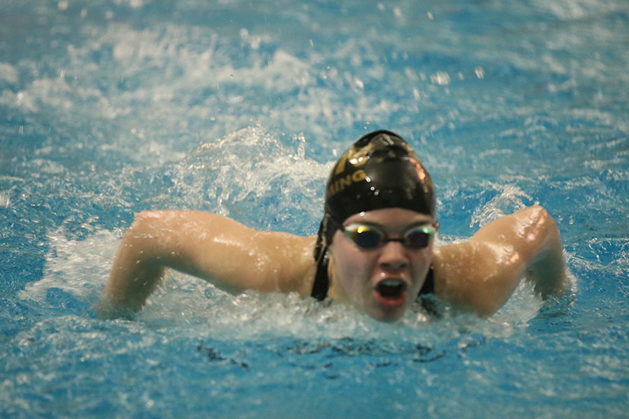 A swimmer from FHN competes in the 100m butterfly event.