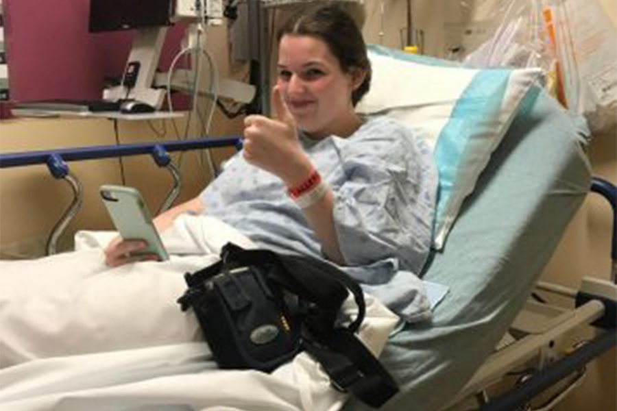Senior Kailee Edelen sits in a hospital bed, before a surgery. (photo submitted)