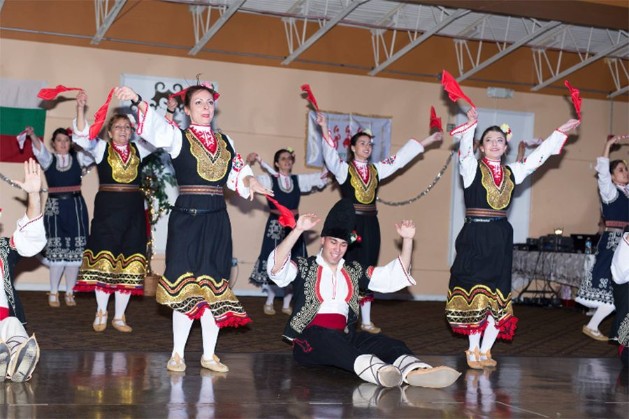 """Junior Michaela Mihova performs with her Bulgarian dance team. Mihova has been doing Bulgarian dance for almost four years and was encouraged by her family to join. The group practices on Sundays at a variety of local dance studios. """"My favorite part is having that small but significant part of Bulgaria with me, being here in America,"""" Mihova said. (Photo submitted)"""